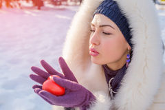 Pretty woman holding red heart in hands Royalty Free Stock Image