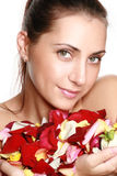 Pretty woman holding rose petals Royalty Free Stock Photo