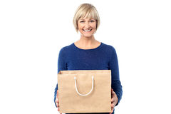 Pretty woman holding shopping bag Stock Photography