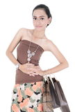 Pretty woman holding shopping bags Royalty Free Stock Images