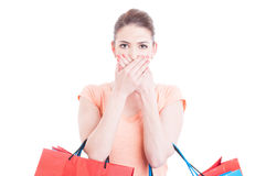 Pretty woman holding shopping bags making mute gesture Royalty Free Stock Photo