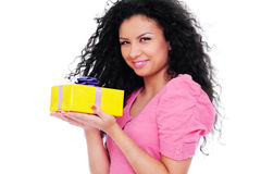 Pretty woman holding small yellow gift Stock Images