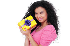 Pretty woman holding small yellow gift Royalty Free Stock Photo
