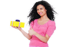 Pretty woman holding small yellow gift Stock Photos