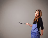 Pretty woman holding a spoon Stock Photos