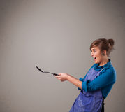 Pretty woman holding a spoon Royalty Free Stock Images