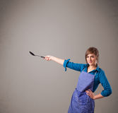 Pretty woman holding a spoon Royalty Free Stock Photography