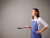 Pretty woman holding a spoon Stock Image