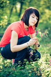 Pretty woman holding spring flowers Stock Images