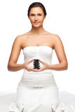Pretty woman holding stones for spa. Pretty woman portrait who holding stones for spa over white Royalty Free Stock Photography