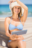 Pretty woman holding tablet pc in the hammock Stock Images