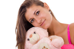 Pretty woman holding teddy bear reminding her of childhood stock photography