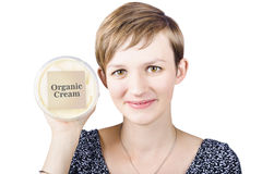 Pretty woman holding a tub of Organic Cream Royalty Free Stock Photo