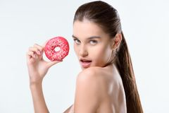 Woman holding donut Stock Images