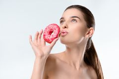 Woman holding donut Royalty Free Stock Images