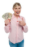 Pretty woman holding up dollar notes Royalty Free Stock Photo