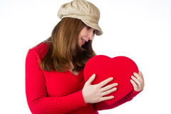 Pretty woman holding a valentines day heart Royalty Free Stock Image
