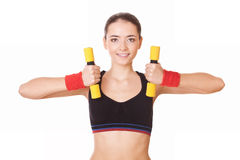 Pretty woman holding weights Royalty Free Stock Photos