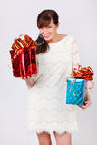 Pretty woman holds boxes with gifts. Royalty Free Stock Photos