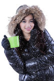 Pretty woman holds mug of hot drink Royalty Free Stock Photos