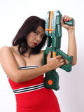 Pretty woman holds toy gun Royalty Free Stock Images