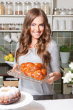 Pretty woman with a homemade cake. Beautiful happy woman with a homemade cake Royalty Free Stock Photo