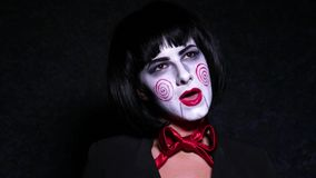 Pretty woman in horror style make up sings a song on dark background Stock Photography
