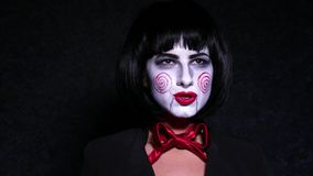 Pretty woman in horror style make up sings a song on dark background Royalty Free Stock Photos