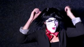 Pretty woman in horror style make up sings a song on dark background Royalty Free Stock Photography