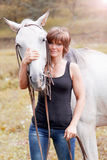 Pretty woman with a horse Stock Images
