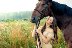 Pretty woman with horses Stock Photo