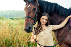Pretty woman with horses Royalty Free Stock Photos