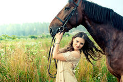 Pretty woman with horses Stock Photos