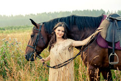 Pretty woman with horses Stock Image