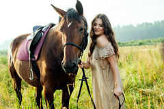 Pretty woman with horses Stock Photography