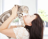 Pretty woman hug and kiss her cat Royalty Free Stock Photography