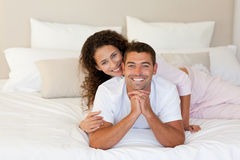 Pretty woman hugging her husband Stock Photography