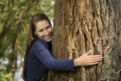 Pretty woman hugging a tree Stock Photos