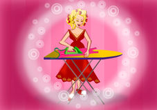 Pretty Woman ironing clothes Royalty Free Stock Photography