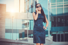 Pretty woman istalking on the phone Stock Photography
