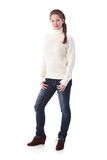 Pretty woman in jeans and sweater smiling Stock Images