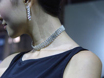 Pretty woman with jewelry. Beautiful young woman with a jewelry Royalty Free Stock Photo