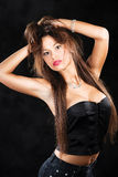 Pretty woman with jewelry and long hair Royalty Free Stock Photo