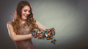 Pretty woman with jewelry necklaces beads and hat. Stock Images