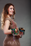 Pretty woman with jewelry necklaces beads and hat. Royalty Free Stock Photo