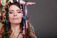 Pretty woman with jewelry necklaces bracelets Stock Photo