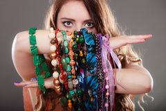 Pretty woman with jewelry necklaces ring bracelets Royalty Free Stock Photo
