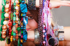 Pretty woman with jewelry necklaces ring bracelets Stock Image