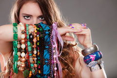 Pretty woman with jewelry necklaces ring bracelets Royalty Free Stock Image