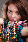 Pretty woman with jewelry necklaces ring bracelets Stock Photo
